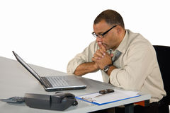 Concentrated businessman sitting at laptop Royalty Free Stock Photos