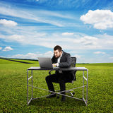 Concentrated businessman sitting Royalty Free Stock Photography