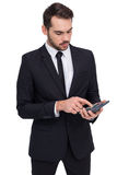 Concentrated businessman in suit using calculator Stock Images