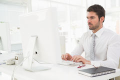 Concentrated businessman typing on keyboard Royalty Free Stock Images