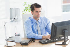 Concentrated businessman typing on the keyboard Royalty Free Stock Images