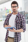 Concentrated businessman using digital tablet Stock Images