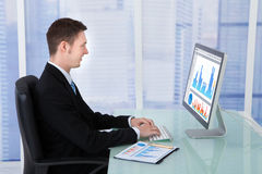 Concentrated Businessman Working On Computer In Office Stock Photography
