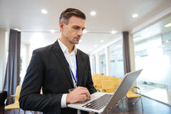 Concentrated businessman working with laptop Royalty Free Stock Photography