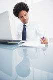 Concentrated businessman writing notes Stock Photos