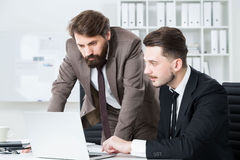 Concentrated businessmen discussing business project Royalty Free Stock Photos