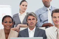 Concentrated businesspeople working at a laptop Royalty Free Stock Images