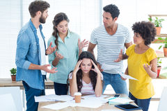 Concentrated businesswoman with her coworkers Stock Photo
