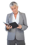Concentrated businesswoman reading notepad Stock Photo
