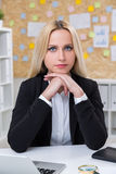 Concentrated businesswoman Stock Image