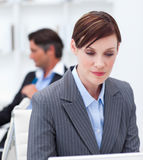 Concentrated businesswoman sitting at office desk Stock Photo