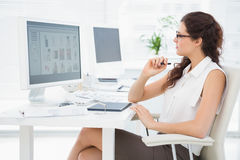Concentrated businesswoman using computer and digitizer Royalty Free Stock Photo