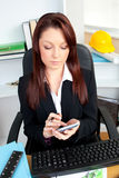 Concentrated businesswoman using her calculator Royalty Free Stock Photography