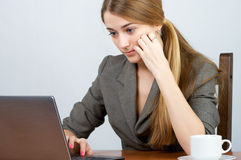 Concentrated businesswoman working Royalty Free Stock Image