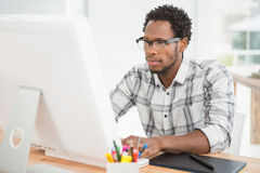 Concentrated casual businessman working with computer Stock Image