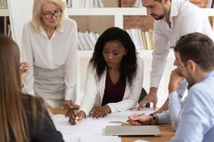 Free Concentrated Colleagues Brainstorm Discussing Paperwork At Briefing Royalty Free Stock Photo - 160764025