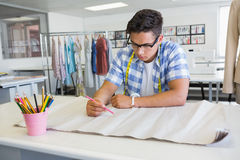 Concentrated college student drawing on paper Stock Image
