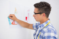 Concentrated college student drawing picture Stock Photography