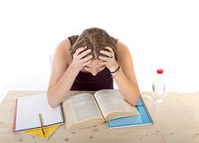 Concentrated college student girl studying for university exam in stress Stock Image