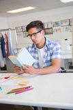 Concentrated college student reading book. At the college Royalty Free Stock Photo