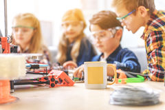 Concentrated company of little inventors Stock Photos