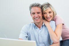 Concentrated content couple using laptop Stock Images