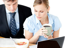 Concentrated couple of businesspeople reading news Stock Photography