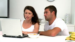Concentrated couple buying on internet with a credit card Stock Image