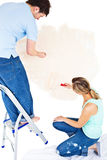 Concentrated couple painting a room Royalty Free Stock Photo