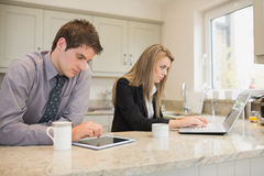 Concentrated couple surfing in the internet Stock Photos