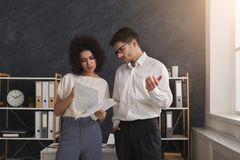 Couple of young colleagues work at modern office stock images