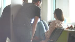 Concentrated couple of young colleagues working in modern office. Two coworkers discussing their work, working with. Documents. man and woman working in the stock footage