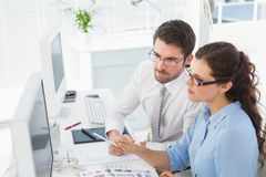 Concentrated coworkers speaking and brainstorming. In the office Stock Photos