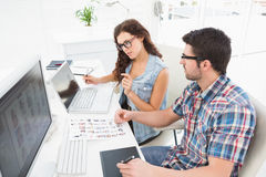 Concentrated coworkers using laptop and digitizer Stock Photo