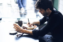 Concentrated creative hipster male blogger Royalty Free Stock Images
