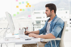 Concentrated designer using computer and digitizer Royalty Free Stock Photo