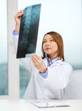 Concentrated doctor looking at x-ray Stock Photos