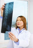 Concentrated doctor looking at x-ray Royalty Free Stock Photos