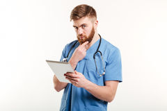 Concentrated doctor or nurse thinking Royalty Free Stock Image