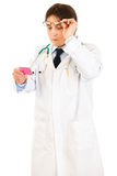 Concentrated doctor reading name of drug Stock Images