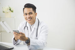 Concentrated doctor with tablet Stock Images