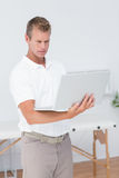 Concentrated doctor using computer Stock Image