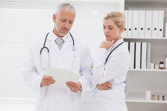 Concentrated doctors coworker analyzing results Royalty Free Stock Photography