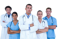Concentrated doctors and nurses looking at the camera. On a white background Royalty Free Stock Image
