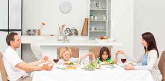 Concentrated family praying before having lunch Royalty Free Stock Images
