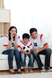 Concentrated family watching football match Stock Image