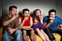 The concentrated fans with a pizza in hands Stock Photography