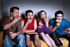 Concentrated fans with a pizza in hands Stock Image