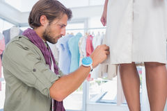 Concentrated fashion designer picking needles Royalty Free Stock Photos