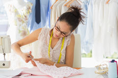 Concentrated fashion designer working on fabrics Royalty Free Stock Image
